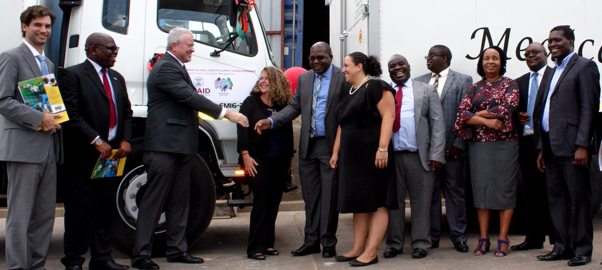 U.S. and Zambian leaders participate in a handover ceremony for 12 trucks donated by the U.S. to Zambia for medicine delivery. Photo credit: USAID/Zambia