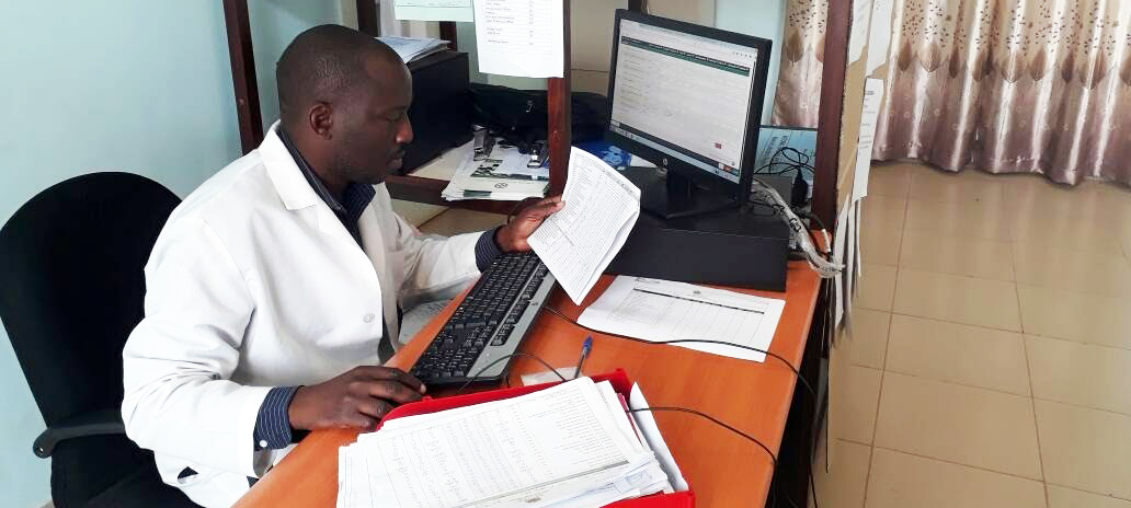 A pharmacy technician from Nkhata Bay district captures health facility data for OpenLMIS during deployment. Photo credit: GHSC-PSM