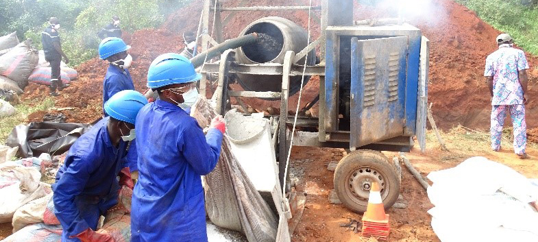 Employees of a local service provider trained by GHCS-TA Francophone TO in safe pharmaceutical waste management are neutralizing counterfeit pharmaceuticals prior to final disposal at an approved landfill site. Photo credit: Chemonics