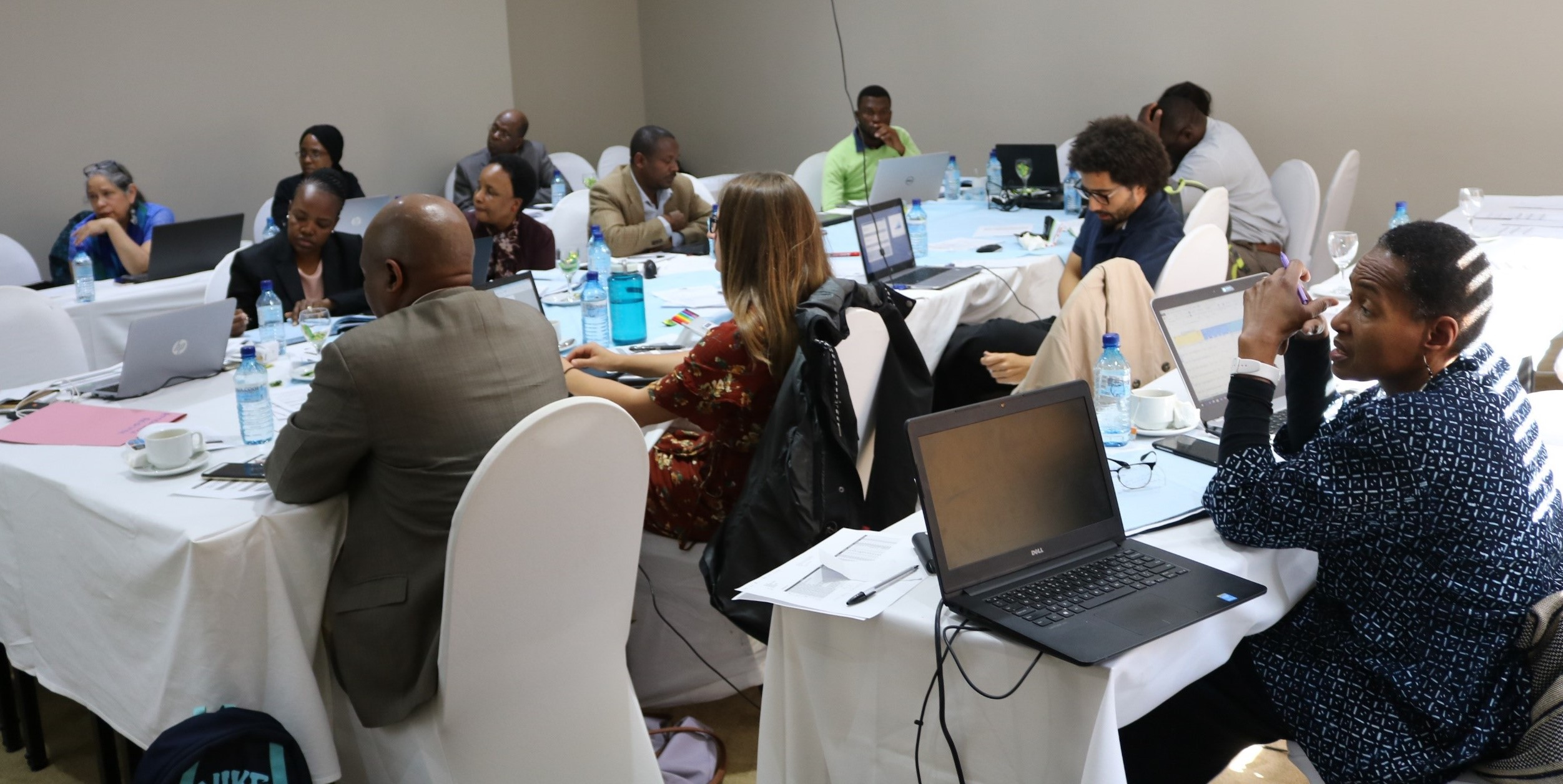 Image of participants in a GHSC-PSM led ARV forecasting and supply planning exercise in Botswana.
