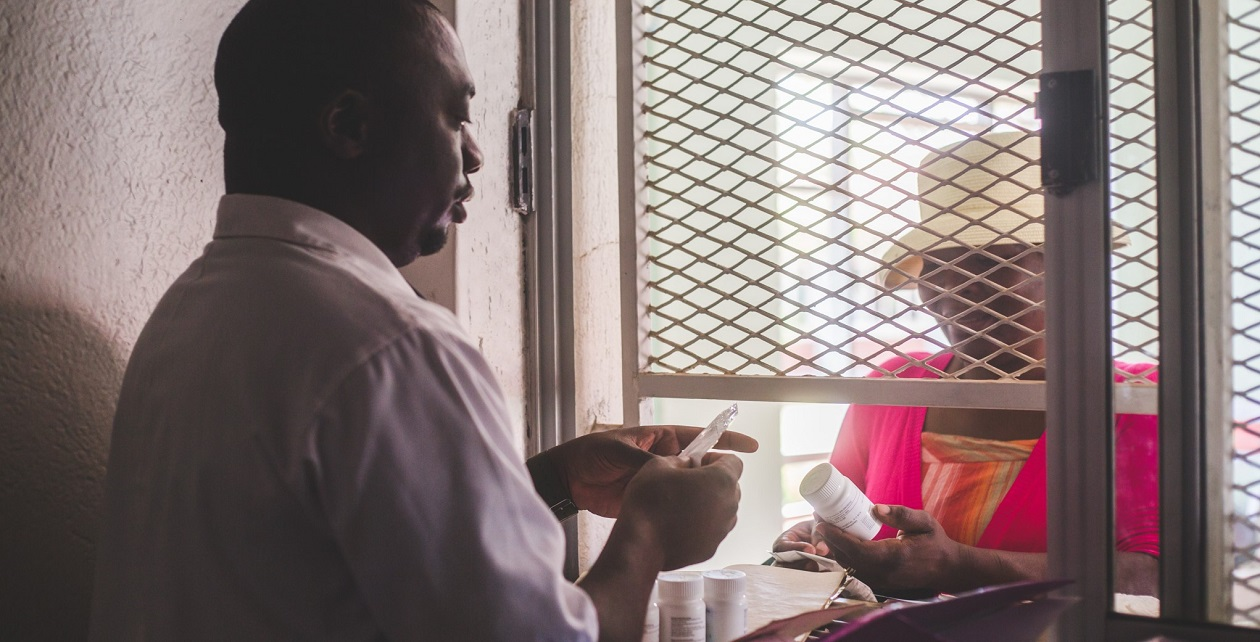 Patient collecting medicine from a pharmacy in Zimbabwe