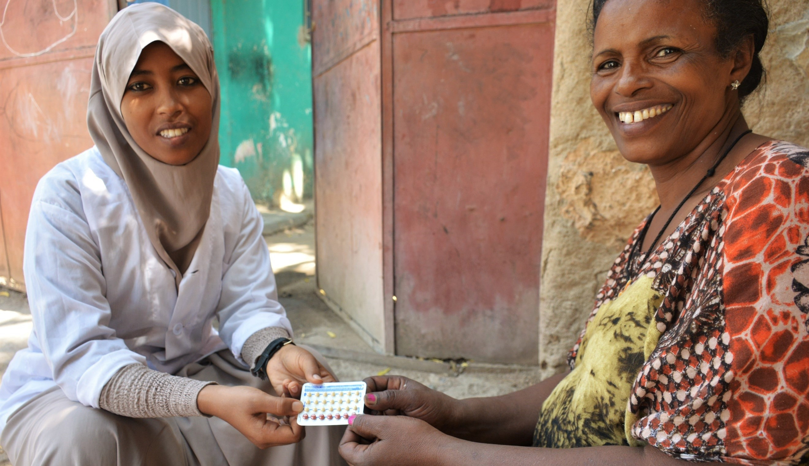 Clinician Zebiba Abdizein (left) and family planning client Mulu Feke (right) chat about family planning services