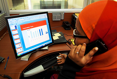Woman data analytics at computer in Kenya