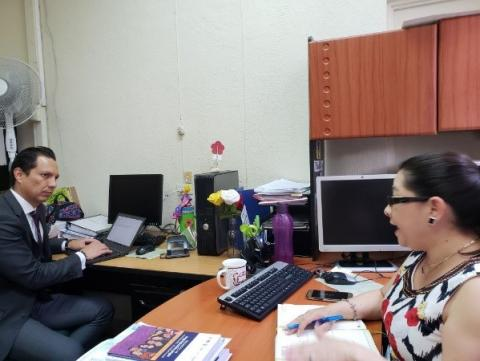 GHSC-PSM Consultant, Luis Miguel Perez, interviews Amalia Azurdia of the MOH Logistics Management Unit for the regional procurement mechanism evaluation. Photo Credit: Patricia Villeda/GHSC-PSM
