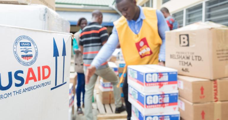 A man unloads USAID-branded boxes